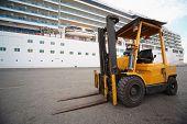 excavator in Qaboos port. focus on excavator's wheel.