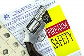 stock photo of revolver  - Concealed Weapon Permit CCW Application with fingerprint card and firearm safety brochure and Revolver Gun - JPG