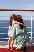 Daughter And Mother Embracing On Cruise Liner Deck
