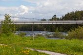 image of suspension  - Suspension bridge over the River Niva Kandalaksha city - JPG