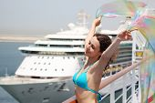 Young Beauty Woman Standing On Cruise Liner Deck In Bikini And Holding Pareo, Half Body poster