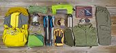 picture of board-walk  - High angled view of organized hiking gear placed on rustic wooden boards in rectangle format - JPG