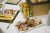 stock photo of banquet  - Holiday Appetizers banquet table setting in restaurant - JPG