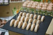 foto of banquet  - Holiday Appetizers banquet table setting in restaurant - JPG