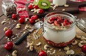 stock photo of wonderful  - Domestic cherry yogurt with wonder chia seeds and granula - JPG