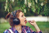 picture of lollipops  - Portrait of pretty attractive girl hipster headphones - JPG