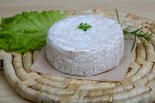 pic of brie cheese  - Brie cheese with salad leaves on the wood background - JPG