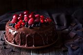 image of icing  - Traditional homemade chocolate cake sweet pastry dessert with brown icing - JPG
