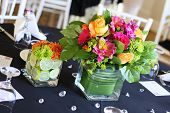 stock photo of flower arrangement  - A beautiful arrangement of flowers on table at reception