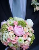 foto of purple rose  - Bridegroom holding beautiful fresh wedding bouquet of pink lilac purple white and violet chrysanthemum rose and peony flowers closeup vertical picture  - JPG