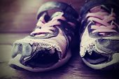 stock photo of hobo  - Old tennis or athletic running shoes with holes in them  - JPG
