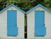 stock photo of beach hut  - colorful wooden beach huts - JPG