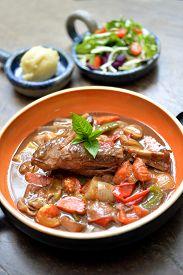 stock photo of lamb shanks  - Lamb shank in gravy with mix vegetable - JPG
