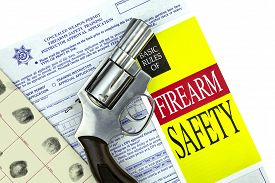 pic of personal safety  - Concealed Weapon Permit CCW Application with fingerprint card and firearm safety brochure and Revolver Gun - JPG