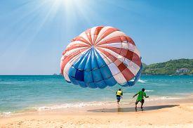 stock photo of parasailing  - Parasailing at Patong Beach in Phuket  - JPG