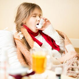 foto of respiratory  - Portrait of sick girl with respiratory illness lying in bed and using inhaler - JPG