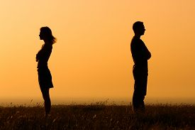 stock photo of angry  - Silhouette of a angry woman and man on each other - JPG