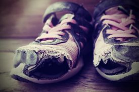 foto of hobo  - Old tennis or athletic running shoes with holes in them  - JPG