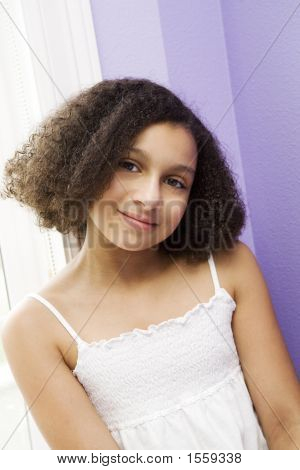 Picture or Photo of Darling preteen girl of mixed ethnicity smiling sweetly