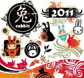 Cartoon oriental vector set of cute bunnies grunge design elements. 2011 is the Year of the Rabbit a