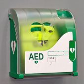 stock photo of defibrillator  - Automated External Defibrillator portable electronic life saver - JPG