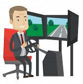 Excited man in a suit playing video game with gaming wheel. Gamer driving autosimulator in game room poster