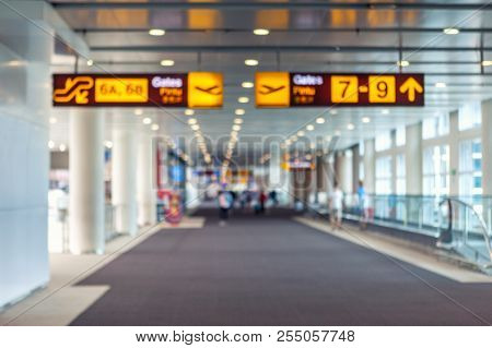 poster of Traveling Concept. Travelers Walking With A Luggage At Airport Terminal Blurred Crowd Of Travelling