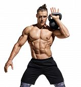 Young Muscular Guy Training With Kettlebell. Photo Of Sporty Model With Naked Torso And Good Physiqu poster