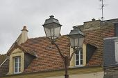 Historic French Homes With Street Light poster