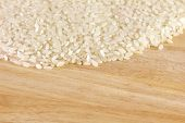 Close Up White Rice On Cutting Board