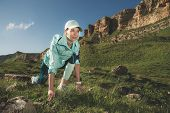 Athletic Woman Was Ready To Run At The Foot Of The Rocks. Fitness Runner In The Finished Starting Li poster