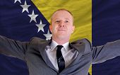 Happy Businessman Because Of Profitable Investment In Bosnia Herzegovina Standing Near Flag