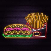 Retro Neon Hot Dog And French Fries Sign On Brick Wall Background. Design For Cafe, Restaurant. Vect poster
