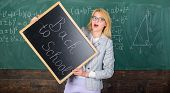 Woman Teacher Holds Blackboard Inscription Back To School. Looking Committed Teacher Complement Qual poster