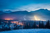 Winter Skiing Competitions At Dusk In Winter In Zakopane, Poland poster