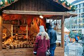 Постер, плакат: People At Stall On Christmas Market At Kaiser Wilhelm Memorial Church In Winter Berlin Germany Adv
