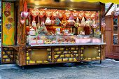 Постер, плакат: Stand With Sweets On Christmas Market At Kaiser Wilhelm Memorial Church In Winter Berlin Germany A