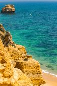 Beach Paradise View. Yellow Sand And Rocks In The Algarve, Portugal. Nice Sunbeam And Shadow. poster