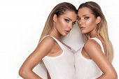Sensual Twins Women Posing On White Background. poster