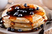 A Plate Of Delicious Blueberry Pancakes With Real Maple Syrup. poster