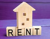 Wooden House On A Purple Background With The Inscription Rent. Rental Of Property, Apartments. Servi poster