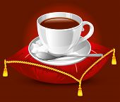 stock photo of coffee-cup  - coffee cup on the red satin pillow with gold tassels - JPG