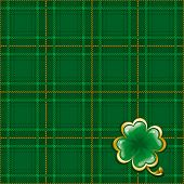 Tartan ornate background to St. Patrick's Day with glossy clover