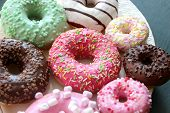 Photos Of Different Donuts. Assorted Colorful Donuts In Pink, Green, Chocolate Icing Close-up, Sweet poster