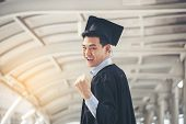Graduate And Success Education In University Concept.happy Student Man Graduate Diploma Degree In As poster