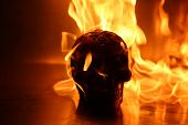 Halloween. Human Skull on fire. Fire and Flames of HELL Burn a Human Skull for all of eternity. Fire poster