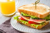 Sandwich With Cheese, Ham And Fresh Vegetables On A Plate. Fresh poster