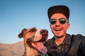 Funny Best Friends Concept: Human Taking A Selfie With Dog. Happy Young Male Person Makes Self Portr poster