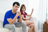 Frustrated Husband Man Sitting Next To His Wife When Looking In Pregnancy Test In Wife Hand. Not A G poster