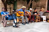 HAVANA-JULY 20:Unidentified men in a traditional music group playing for tourists July 20,2012 in Ha